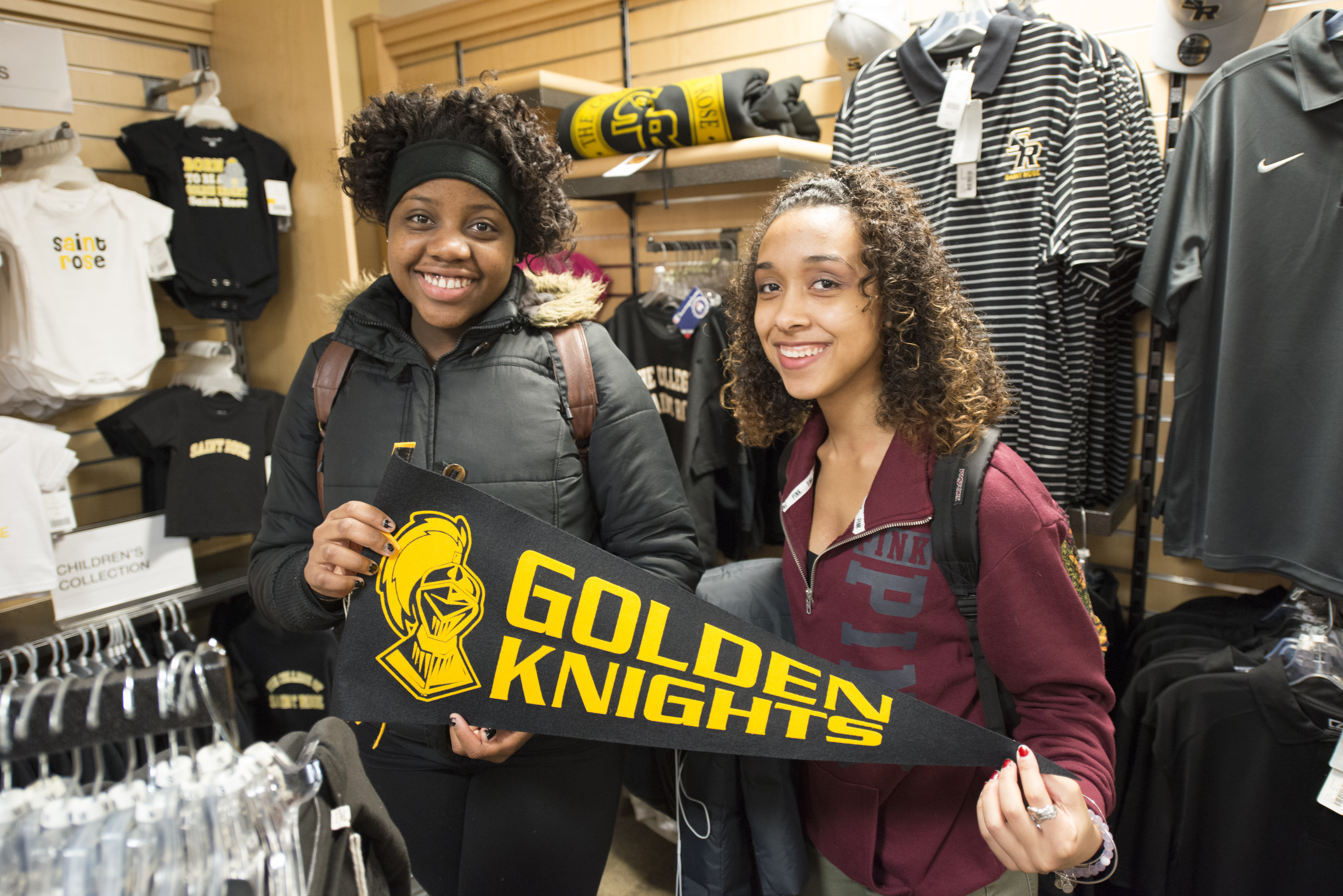 Two Girls holding flag at Saint Rose Bookstore